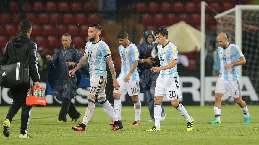 Argentina's players leave the field after a 2018 World Cup qualifying soccer match against Venezuela, in Merida, Venezuela, Tuesday, Sept. 6, 2016.(AP Photo/Fernando Llano)