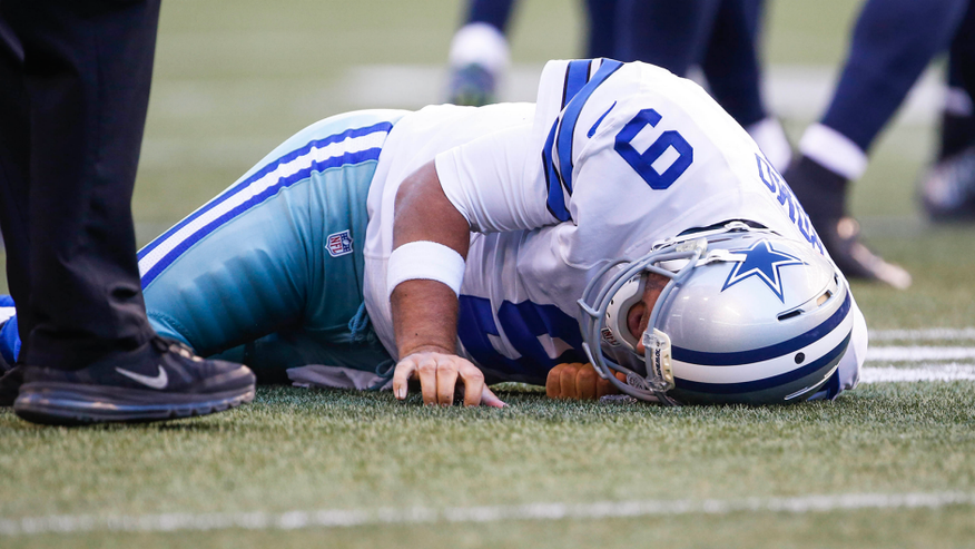 Aug 25, 2016; Seattle, WA, USA; Dallas Cowboys quarterback Tony Romo (9) lies on the turf after a tackle against the Seattle Seahawks during the first quarter at CenturyLink Field. Mandatory Credit: Joe Nicholson-USA TODAY Sports