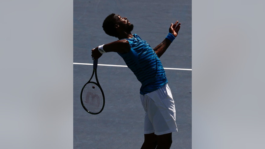 Gael Monfils, of France, serves to Marcos Baghdatis, of Cyprus, during the fourth round of the U.S. Open tennis tournament, Sunday, Sept. 4, 2016, in New York. (AP Photo/Andres Kudacki)