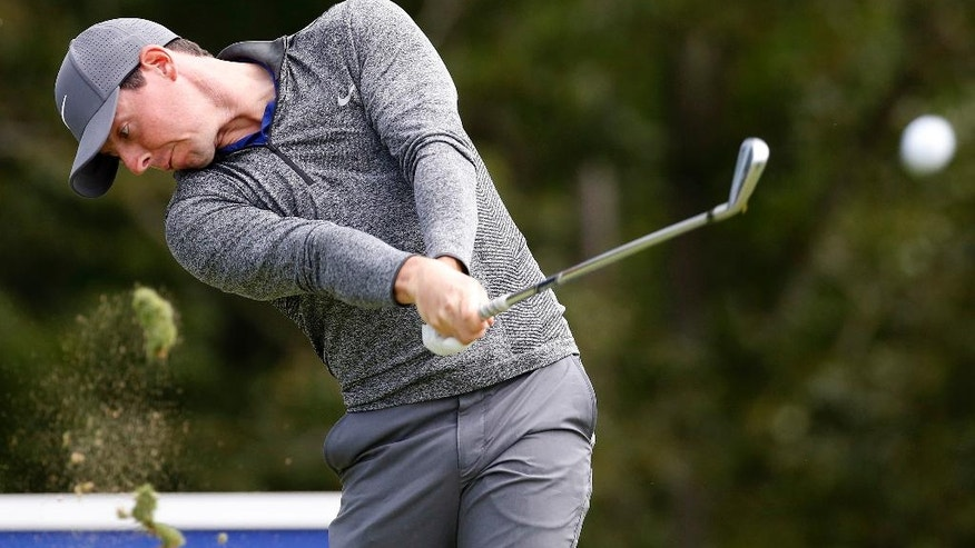 Rory McIlroy, of Northern Ireland, tees off on the 17th hole during the final round of the Deutsche Bank Championship golf tournament in Norton, Mass., Monday, Sept. 5, 2016. (AP Photo/Michael Dwyer)