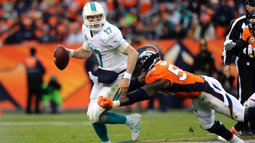 DENVER, CO - NOVEMBER 23: Miami Dolphins quarterback Ryan Tannehill scrambles away from Denver Broncos linebacker Von Miller in the first half at Sports Authority Field at Mile High on Sunday, November 23, 2014. (Photo by Steve Nehf/The Denver Post via Getty Images)