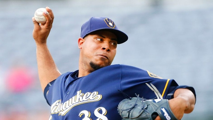 Milwaukee Brewers starting pitcher Wily Peralta delivers during the first inning of a baseball game against the Atlanta Braves on Thursday, May 26, 2016, in Atlanta. (AP Photo/John Bazemore)