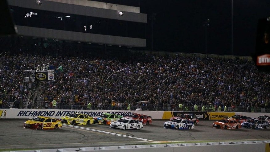 Joey Logano, driver of the #22 Shell Pennzoil Ford, leads a pack of cars during the NASCAR Sprint Cup Series Federated Auto Parts 400 at Richmond International Raceway on September 12, 2015 in Richmond, Virginia.