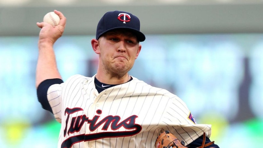 Minnesota Twins starting pitcher Tyler Duffey throws to the Kansas City Royals in the first inning on Saturday, Aug., 13, 2016, in Minneapolis.