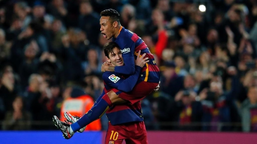 FILE - In this Feb. 28, 2016, file photo, FC Barcelona's Lionel Messi, left, celebrates after scoring against Sevilla with his teammate Neymar during a Spanish La Liga soccer match at the Camp Nou stadium in Barcelona, Spain. Looking to capitalize on its biggest assets — superstars like Messi and Neymar — and the growing popularity of soccer in the U.S., Barcelona opened a commercial office in New York this week that will lead the team's efforts to expand its business, gain more fans across the Atlantic and help the sport grow in America.  (AP Photo/Manu Fernandez File)