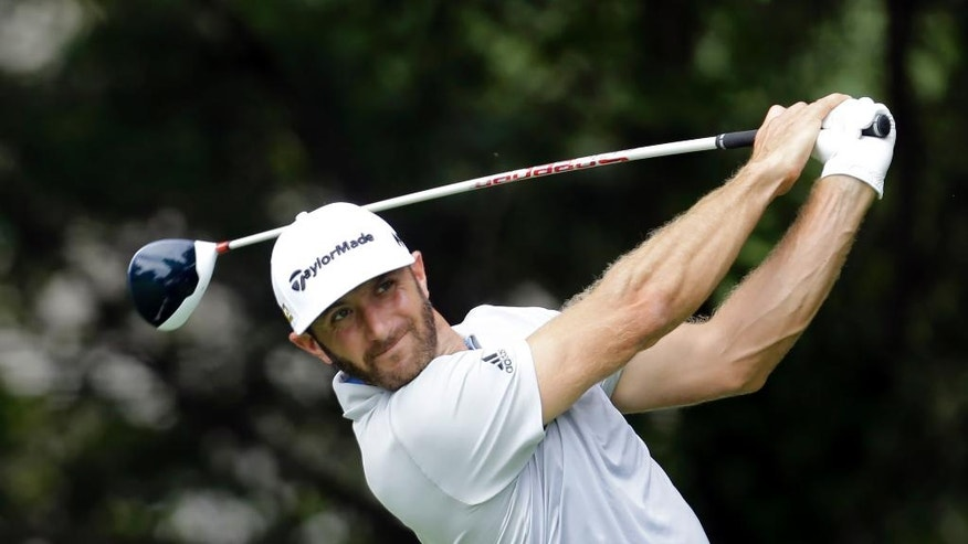 Dustin Johnson watches his drive off the tee on the fifth hole during the second round of the BMW Championship golf tournament at Crooked Stick Golf Club in Carmel, Ind., Friday, Sept. 9, 2016. (AP Photo/AJ Mast)