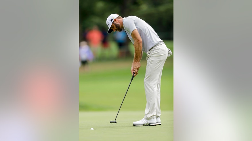 Dustin Johnson sinks a putt on the fourth hole during the second round of the BMW Championship golf tournament at Crooked Stick Golf Club in Carmel, Ind., Friday, Sept. 9, 2016. (AP Photo/AJ Mast)