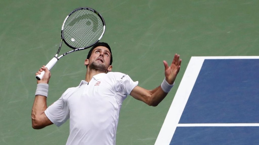 Novak Djokovic, of Serbia, serves to Gael Monfils, of France, during the semifinals of the U.S. Open tennis tournament, Friday, Sept. 9, 2016, in New York. (AP Photo/Seth Wenig)