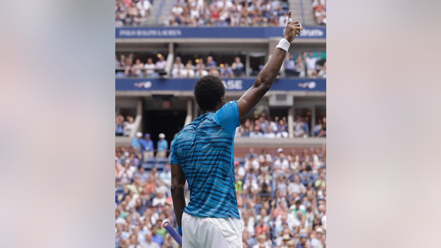 Gael Monfils, of France, reacts to the crowd after a point against Novak Djokovic, of Serbia, during the semifinals of the U.S. Open tennis tournament, Friday, Sept. 9, 2016, in New York. (AP Photo/Darron Cummings)
