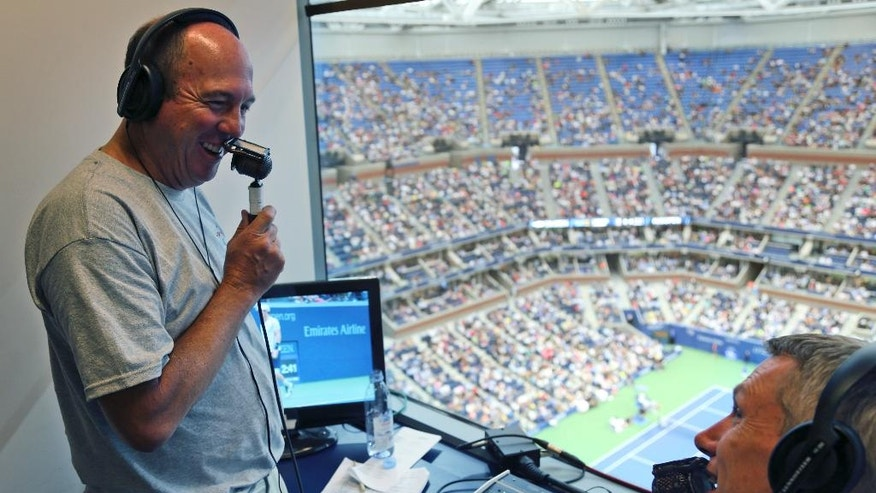 BBC radio broadcasters David Law, right, and Jeff Tarango call a match between Andy Murray, of the United Kingdom, and Kei Nishikori, of Japan, at the U.S. Open tennis tournament in New York, Wednesday, Sept. 7, 2016. Nearly 400 organizations from around the world are covering this year's U.S. Open, yet only two outlets, the BBC and U.S. Open Radio, call matches just for the ear. (AP Photo/Seth Wenig)