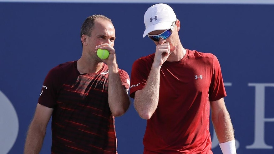 Bruno Soares, of Brazil, left, talks with doubles partner Jamie Murray, of the United Kingdom, during the men's doubles semifinals against Pierre-Hugues Herbert, of France, and Nicolas Mahut, of France, at the U.S. Open tennis tournament, Thursday, Sept. 8, 2016, in New York. (AP Photo/Charles Krupa)