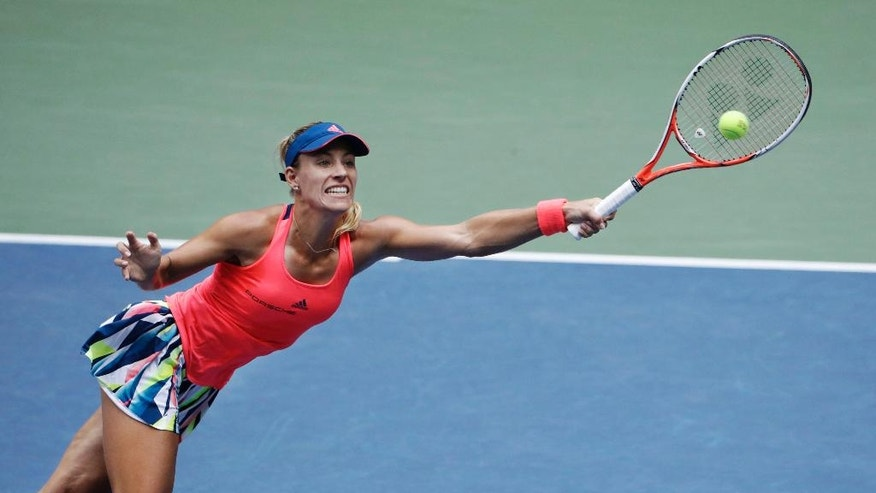 Angelique Kerber, of Germany, reaches to returns a shot to Karolina Pliskova, of the Czech Republic, during the women's singles final of the U.S. Open tennis tournament, Saturday, Sept. 10, 2016, in New York. (AP Photo/Seth Wenig)