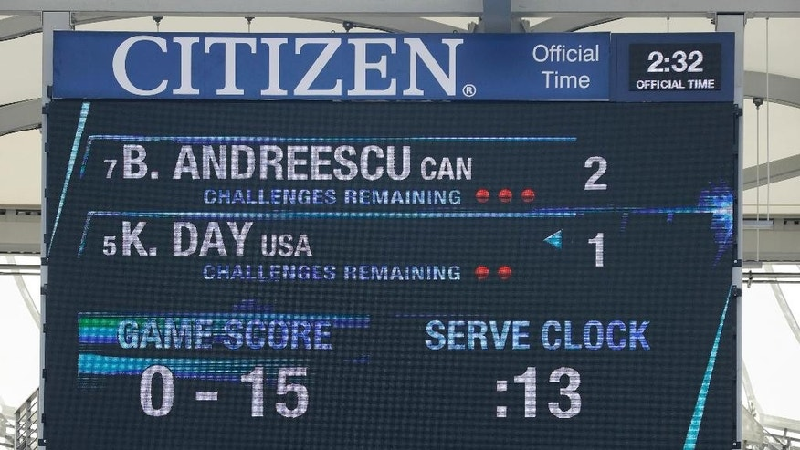 Fans watch a junior girls semifinal match as the serve clock winds down on the scoreboard above during the U.S. Open tennis tournament, Saturday, Sept. 10, 2016, in New York. (AP Photo/Darron Cummings)