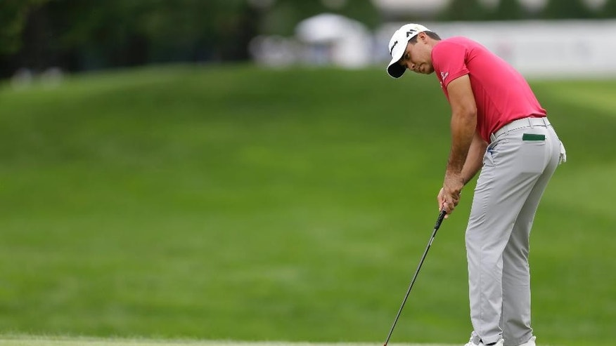 Jason Day, of Australia, putts on the first hole during the third round of the BMW Championship golf tournament at Crooked Stick Golf Club in Carmel, Ind., Saturday, Sept. 10, 2016. (AP Photo/AJ Mast)