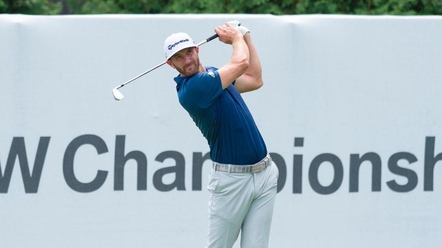Dustin Johnson tees off from the first tee box during the final round of the BMW Championship golf tournament at Crooked Stick Golf Club in Carmel, Ind., Sunday, Sept. 11, 2016. (AP Photo/Doug McSchooler)