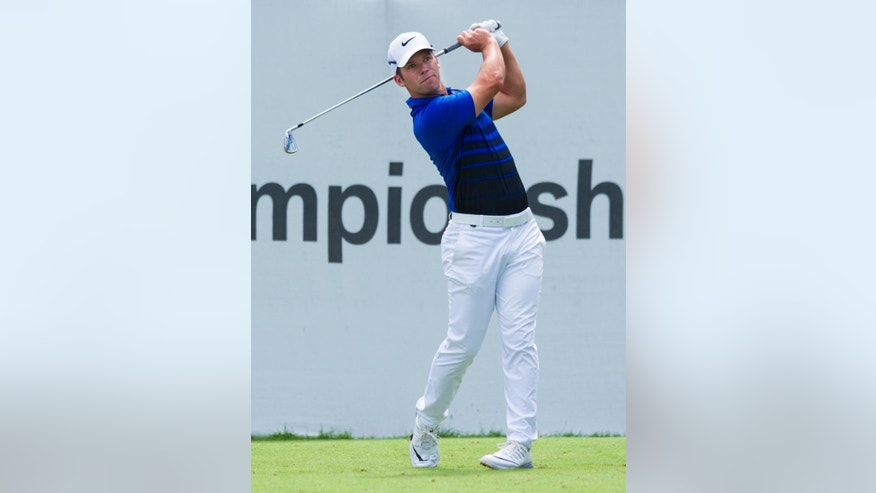 Paul Casey, of England, tees off from the first tee box during the final round of the BMW Championship golf tournament at Crooked Stick Golf Club in Carmel, Ind., Sunday, Sept. 11, 2016. (AP Photo/Doug McSchooler)