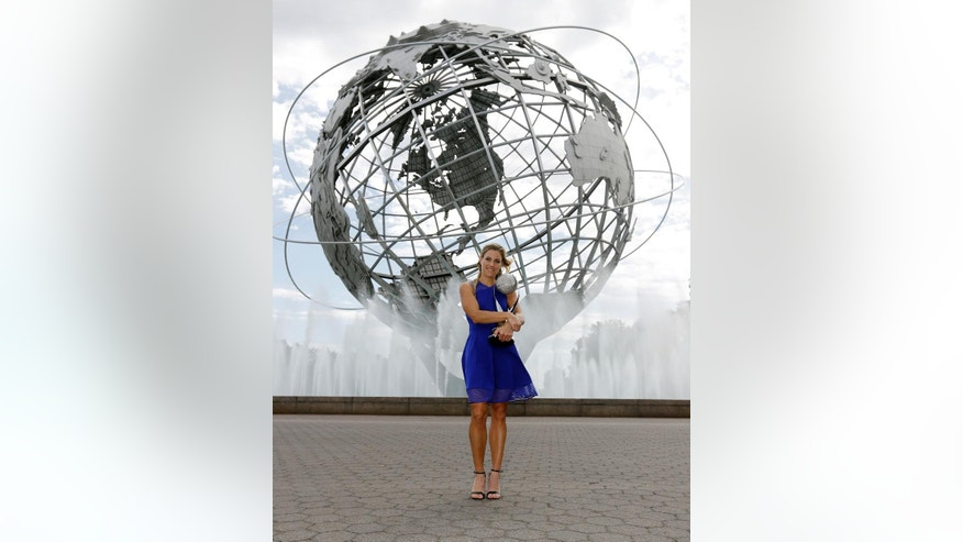 Angelique Kerber, of Germany, poses with the WTA No. 1 trophy after winning the women's single final at the U.S. Open tennis tournament, Sunday, Sept. 11, 2016, in New York. (AP Photo/Darron Cummings)