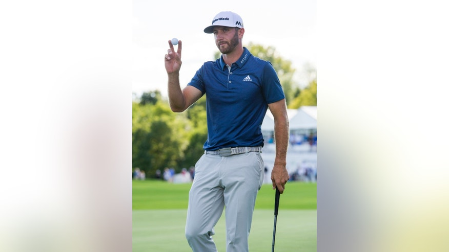 Dustin Johnson reacts to winning the tournament on the 18th green following the final round of the BMW Championship golf tournament at Crooked Stick Golf Club in Carmel, Ind., Sunday, Sept. 11, 2016. (AP Photo/Doug McSchooler)