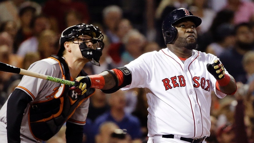 Boston Red Sox designated hitter David Ortiz, right, hits a solo homer as Baltimore Orioles catcher Matt Wieters watches in the sixth inning of a baseball game at Fenway Park, Monday, Sept. 12, 2016, in Boston. (AP Photo/Elise Amendola)