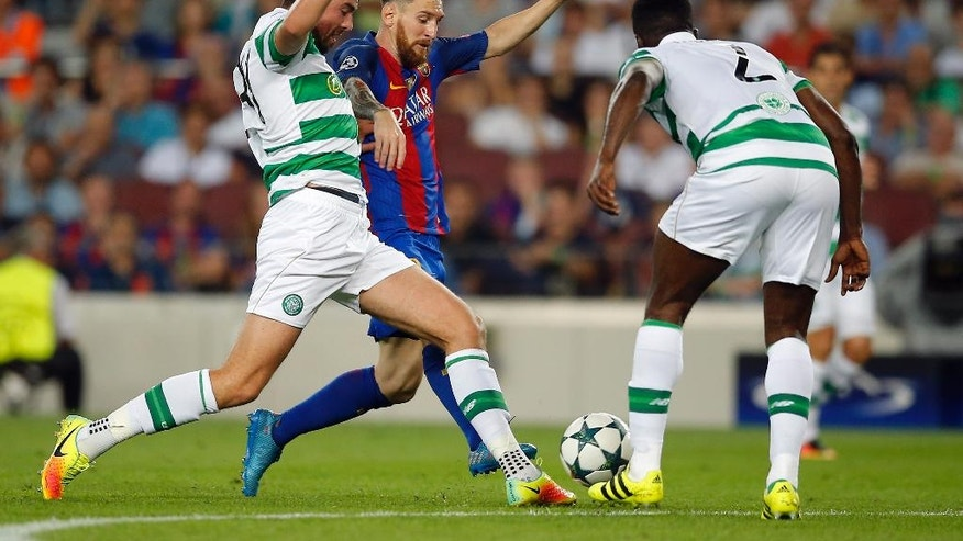 Barcelona's Lionel Messi center, makes his way through Celtic's defense during a Champions League, Group C soccer match between Barcelona and Celtic, at the Camp Nou stadium in Barcelona, Spain, Tuesday, Sept. 13, 2016. (AP Photo/Manu Fernandez)