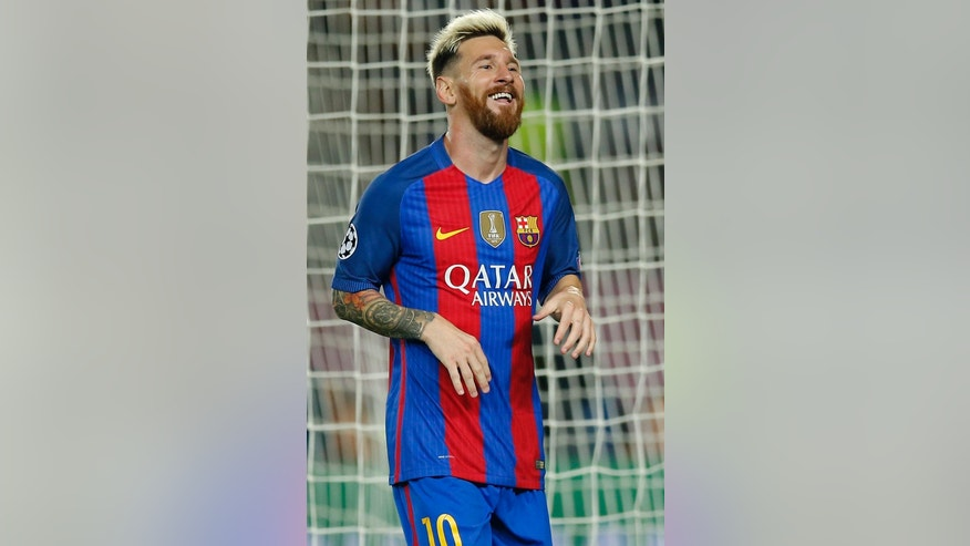 Barcelona's Lionel Messi celebrates after scoring his side's fifth goal during a Champions League, Group C soccer match between Barcelona and Celtic, at the Camp Nou stadium in Barcelona, Spain, Tuesday, Sept. 13, 2016. (AP Photo/Manu Fernandez)