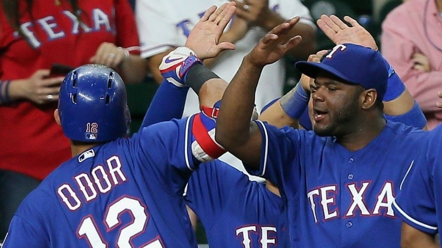<p>HOUSTON, TX - SEPTEMBER 12: Rougned Odor #12 of the Texas Rangers celebrates with his teammates after hitting home run in the twelfth inning Houston Astros at Minute Maid Park on September 12, 2016 in Houston, Texas. (Photo by Bob Levey/Getty Images)</p>