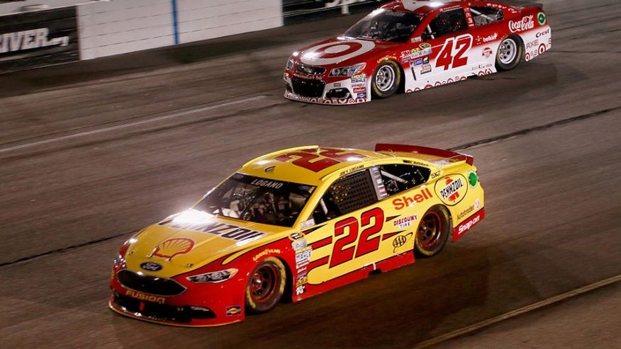 RICHMOND, VA - SEPTEMBER 10: Joey Logano, driver of the #22 Shell Pennzoil Ford, races Kyle Larson, driver of the #42 Target Chevrolet, during the NASCAR Sprint Cup Series Federated Auto Parts 400 at Richmond International Raceway on September 10, 2016 in Richmond, Virginia. (Photo by Matt Sullivan/NASCAR via Getty Images)
