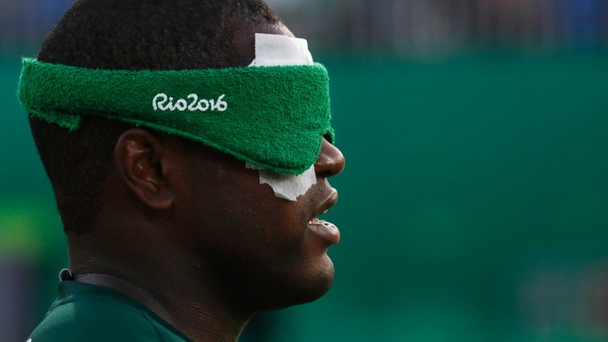 In this Sunday, Sept. 11, 2016, photo, Brazil's Jeferson da Conceicao Goncalves listens during a five-a-side soccer match against Turkey, which Brazil won 2-0, at the Paralympic Games in Rio de Janeiro. In soccer five-a-side, each team competes with four blindfolded players and one goalie who is not visually impaired. (Casey Sykes/University of Georgia via AP)
