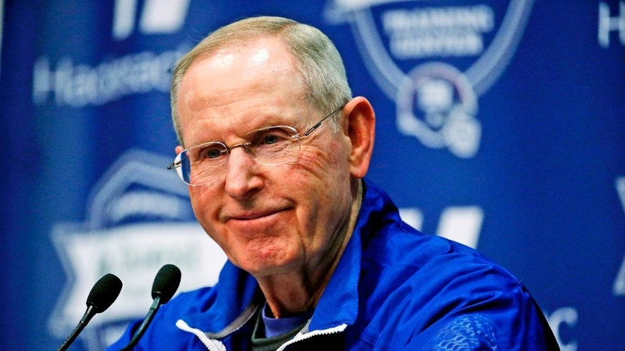 FILE - In this Oct. 28, 2015, file photo, New York Giants head coach Tom Coughlin talks to reporters during NFL football practice in East Rutherford, N.J. The opening of Graeme McDowell's restaurant near PGA Tour headquarters in Ponte Vedra Beach, Fla., brought him together with Coughlin because their foundations were founded on the same principles of helping families of sick children. (AP Photo/Julio Cortez)