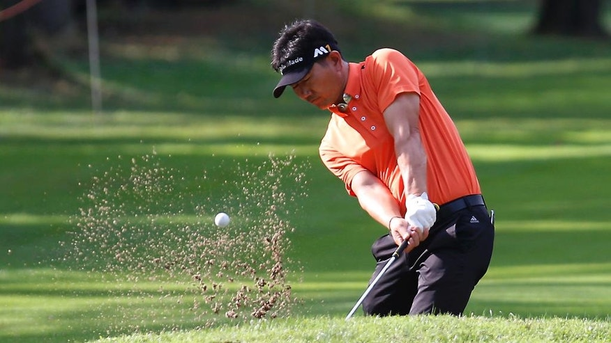 South Korea 's Yang Yong-eun hits the ball out of a bunker during the 73th Italy Open Golf Championship in Monza, Italy, Thursday, Sept. 15, 2016. (AP Photo/Antonio Calanni)