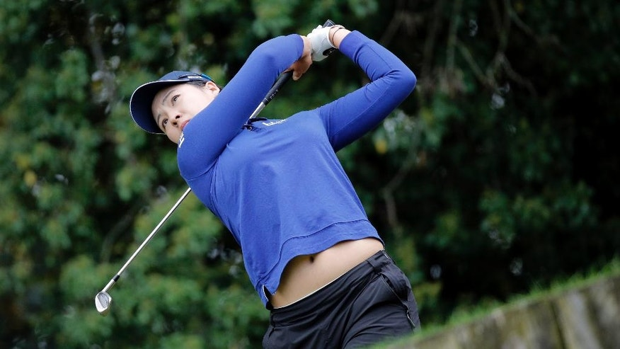 In Gee Chun of South Korea follows the flight of her ball after playing on the 2nd hole during the second round of the Evian Championship women's golf tournament in Evian, eastern France, Friday, Sept. 16, 2016. (AP Photo/Laurent Cipriani)