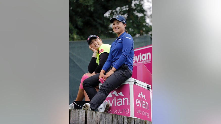 In Gee Chun of South Korea, right, chats with Ariya Jutanugarn of Thailand before playing on the 2nd hole during the second round of the Evian Championship women's golf tournament in Evian, eastern France, Friday, Sept. 16, 2016. (AP Photo/Laurent Cipriani)