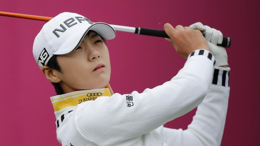 Sung Hyun Park of South Korea follows the flight of her ball after playing on the 1st hole during the third round of the Evian Championship women's golf tournament in Evian, eastern France, Saturday, Sept. 17, 2016. (AP Photo/Laurent Cipriani)