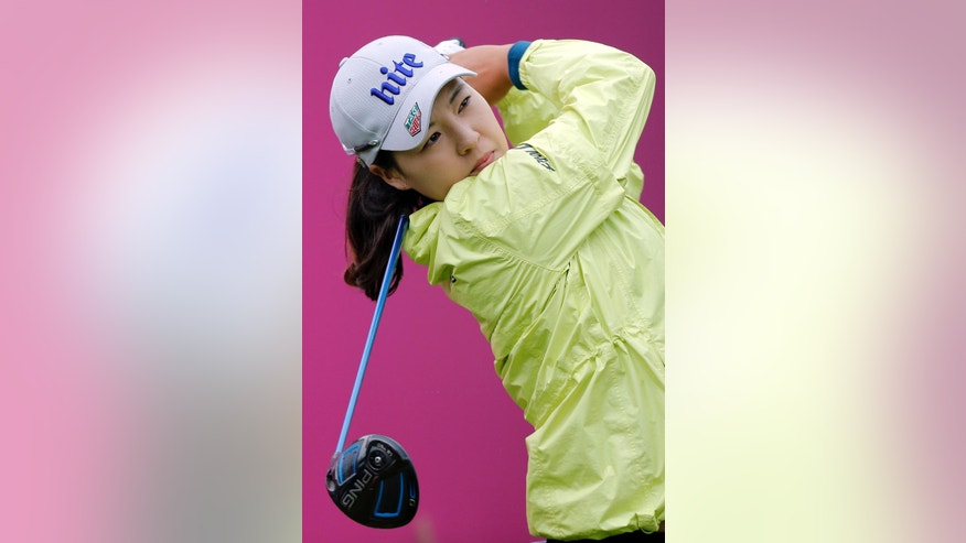 In Gee Chun of South Korea follows the flights of her ball after playing on the 2nd hole during the third round of the Evian Championship women's golf tournament in Evian, eastern France, Saturday, Sept. 17, 2016. (AP Photo/Laurent Cipriani)