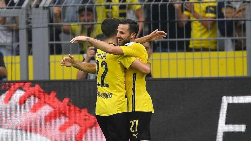 Dortmund's Gonzalo Castro, right, celebrates his second goal with scorer Dortmund's Christian Pulisic during the German Bundesliga soccer match between Borussia Dortmund and SV Darmstadt in Dortmund, Germany, Saturday, Sept. 17, 2016. (AP Photo/Martin Meissner)