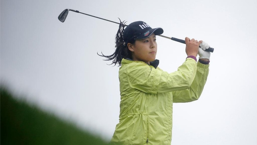 In Gee Chun of South Korea follows the flight of her ball after playing on the 5th hole, during the final round of the Evian Championship women's golf tournament in Evian, eastern France, Sunday, Sept. 18, 2016. (AP Photo/Laurent Cipriani)