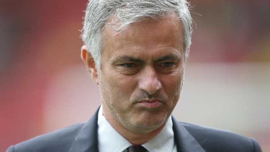 Manchester United manager Jose Mourinho looks across the pitch before the English Premier League soccer match between Watford and Manchester United at Vicarage Road in London, Sunday Sept. 18, 2016. (AP Photo/Tim Ireland)