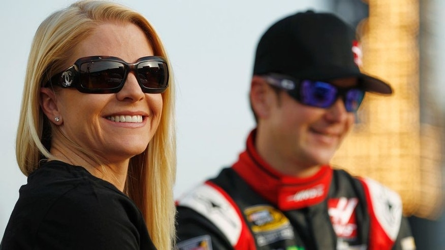 CHARLOTTE, NC - MAY 22: Patricia Driscoll stands on the grid with Kurt Busch, driver of the #41 Haas Automation Made in America Chevrolet, during qualifying for the NASCAR Sprint Cup Series Coca-Cola 600 at Charlotte Motor Speedway on May 22, 2014 in Charlotte, North Carolina. (Photo by Jeff Zelevansky/NASCAR via Getty Images)