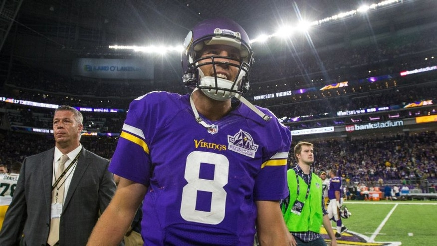 Minnesota Vikings quarterback Sam Bradford smiles following his debut for the team. Bradford completed 22 passes for 286 yards and two touchdowns in a win over the Green Bay Packers.