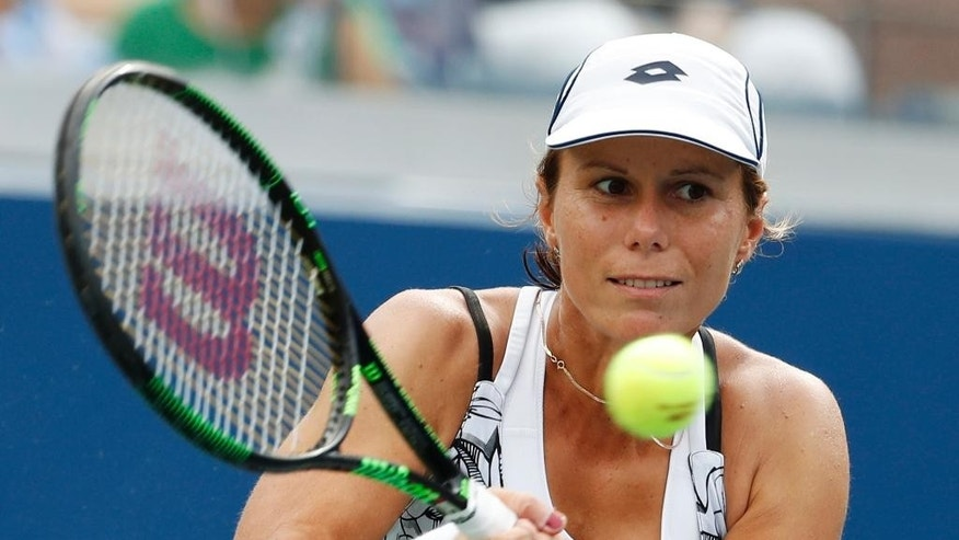 "FILE - In this Sept. 3, 2016, file photo, Varvara Lepchenko, of the United States, returns a shot to Ana Konjuh, of Croatia, during the third round of the U.S. Open tennis tournament in New York. Lepchenko tested positive four times for meldonium, according to the International Tennis Federation, which cleared her because it was determined she took the substance before its ban went into effect on Jan. 1. The ITF announced Tuesday, Sept. 20, 2016, that Lepchenko had been provisionally suspended in March but it was later determined that she ""bore no fault or negligence for the violation."" (AP Photo/Alex Brandon, File)"