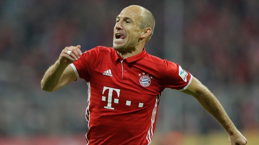 Bayern's Arjen Robben celebrates after scoring his side's third goal during the German Bundesliga soccer match between FC Bayern Munich and Hertha BSC at the Allianz Arena stadium in Munich, Germany, Wednesday, Sept. 21, 2016. (AP Photo/Matthias Schrader)