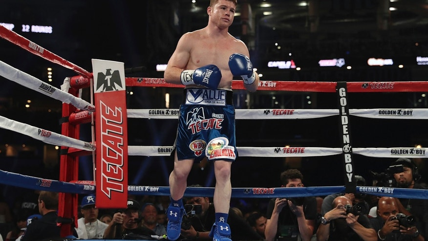 DALLAS, UNITED STATES - SEPTEMBER 17:  Canelo Alvarez looks on during the Canelo v Smith - WBO Middleweight World Championship Fight at AT&T Stadium on September 17, 2016 in Dallas, United States. (Photo by Omar Vega/LatinContent/Getty Images)