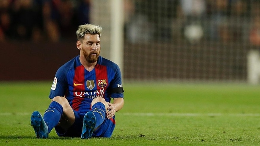 FC Barcelona's Lionel Messi pauses during the Spanish La Liga soccer match against Atletico Madrid at the Camp Nou in Barcelona, Spain, Wednesday, Sept. 21, 2016. (AP Photo/Manu Fernandez)