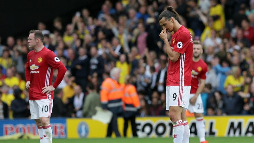 Manchester United's Zlatan Ibrahimovic, right, and Wayne Rooney look dejected after Watford's second goal during the English Premier League soccer match between Watford and Manchester United at Vicarage Road in London, Sunday Sept. 18, 2016. (AP Photo/Tim Ireland)
