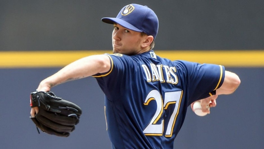 Jun 12, 2016; Milwaukee, WI, USA; Milwaukee Brewers pitcher Zach Davies (27) pitches in the first inning against the New York Mets at Miller Park. Mandatory Credit: Benny Sieu-USA TODAY Sports