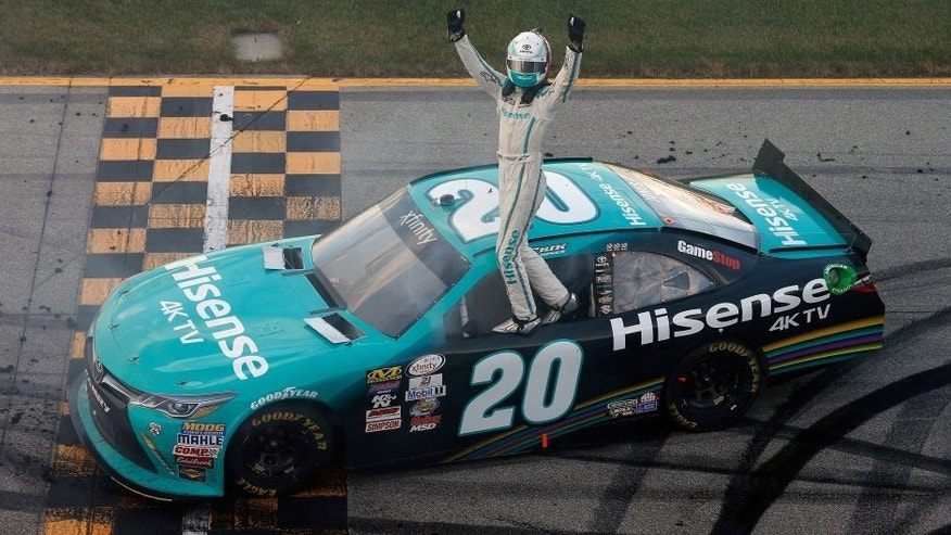 JOLIET, IL - SEPTEMBER 17: Erik Jones, driver of the #20 Hisense Toyota, celebrates after winning the NASCAR XFINITY Series Drive for Safety 300 at Chicagoland Speedway on September 17, 2016 in Joliet, Illinois. (Photo by Brian Lawdermilk/NASCAR via Getty Images)