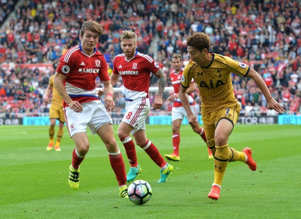 Tottenham Hotspur's Heung-Min Son, right, takes on Middlesbrough's Marten De Roon ,left, during the English Premier League soccer match between Middlesbrough and Tottenham Hotspur at the Riverside Stadium in Middlesbrough, England, Saturday, Sept, 24, 2016. (Anna Gowthorpe/PA via AP)