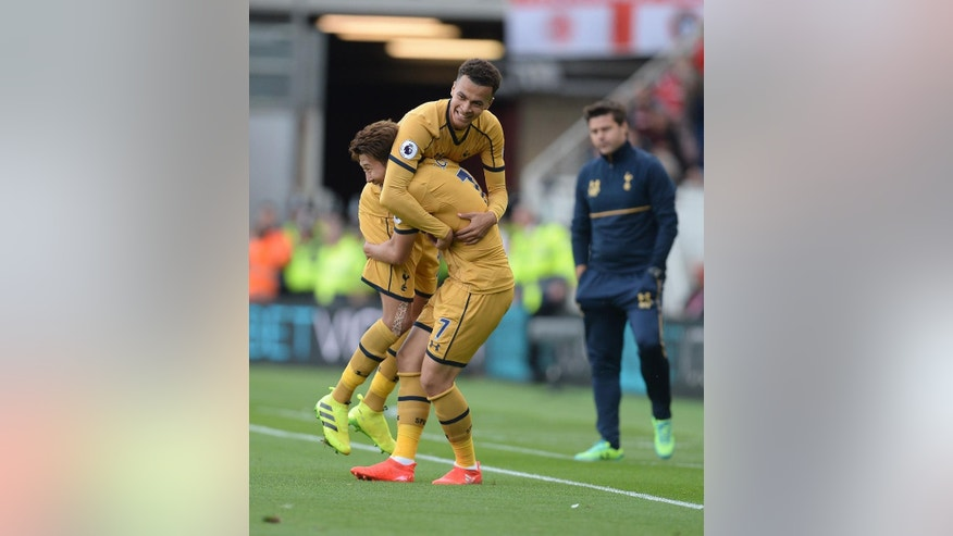 Tottenham Hotspur's Heung-Min Son celebrates with Dele Alli after scoring his side's first goal during the English Premier League soccer match between Middlesbrough and Tottenham Hotspur at the Riverside Stadium in Middlesbrough, England, Saturday, Sept, 24, 2016. (Anna Gowthorpe/PA via AP)