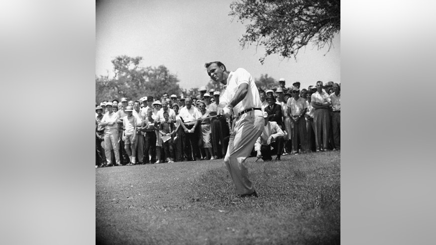 "File-This April 29, 1962, file photo shows Arnold Palmer, lifting an iron shot from No. 5 fairway in the final round of the Texas Open in San Antonio. Palmer, who made golf popular for the masses with his hard-charging style, incomparable charisma and a personal touch that made him known throughout the golf world as ""The King,"" died Sunday, Sept. 25, 2016, in Pittsburgh. He was 87.  (AP Photo/Ted Powers)"