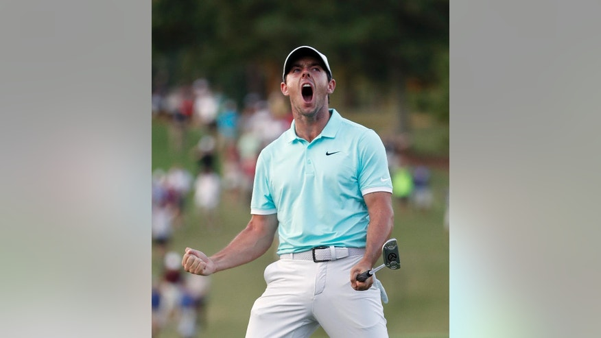 Rory McIlroy reacts after sinking a putt on the fourth hole to win the Tour Championship golf tournament and the FedEx Cup at East Lake Golf Club, Sunday, Sept. 25, 2016, in Atlanta. (AP Photo/John Bazemore)